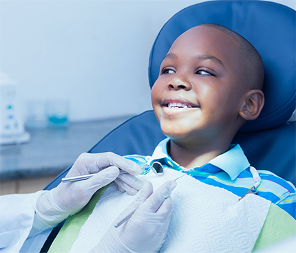 Close up of boy having his teeth examined by a dentist
